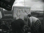 Laying of a wreath at the memorial stone on the Waal bridge