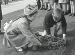 British children visit the graves of their fallen fathers